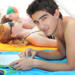 Three young adults at the beach — Stock Photo