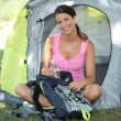 Female camper sat by tent — Stock Photo