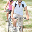 Stock Photo: Couple riding bikes