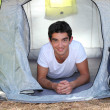Royalty-Free Stock Photo: Teenager in a tent
