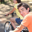 Teenage boy and girl on bike ride — Stok fotoğraf
