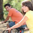 Young biking in the forest — Stock Photo