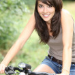Splendid-looking brunette on her bike — Stock Photo #7908648