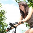 Young woman riding bicycle — Stock Photo