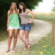 Couple of girls standing on a county path — Stock Photo