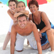 Family holidaying on a sandy beach — Stock Photo #7908970