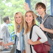 Group of students at college entrance — Stock Photo