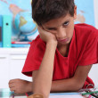 Schoolboy visibly bored - Stock Photo