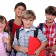 Schoolchildren, studio shot — Stockfoto #7909673