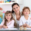 Stock Photo: Woman with young children learning about the world