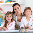 Stock Photo: Womwith young children learning about world