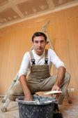 Man mixing plaster — Stock Photo