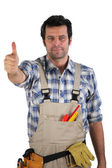 Worker giving the thumbs up — Stock Photo