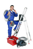 Electrician with mobile telephone — Stock Photo
