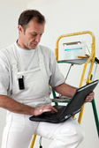 Decorator with a laptop — Stock Photo
