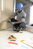 Black electrician at work — Stock Photo