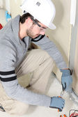 Electrical worker testing socket — Stock Photo