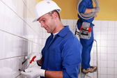 Electrical team wiring wall sockets — Stock Photo