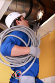 Electrician wiring an industrial loft space — Stock Photo