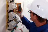 Electrical inspector reading power output — Stockfoto