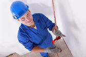 Smiling laborer installing piping — Stock Photo