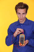 Electrician using a multimeter — Stock Photo