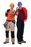 Electrician and plumber displaying equipment — Stock Photo