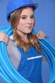 Female electrician with wiring — Stock Photo