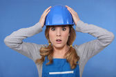 Shocked female builder — Stock Photo