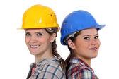 Tradeswomen permanente de costas — Fotografia Stock
