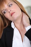 Closeup of a businesswoman with neckache — Stock Photo