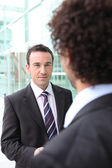 Two male businessmen shaking hands — Stock Photo