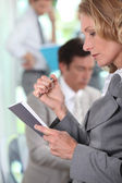 Businesswoman reading — Stock Photo