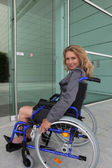 Businesswoman in a wheelchair — Stock Photo