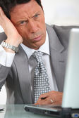 Businessman looking confused — Stock Photo
