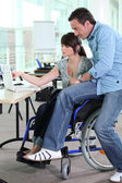 Girl working in a wheelchair — Stock Photo