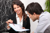 Businesswoman discussing a contract with her client — Stock Photo