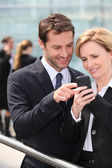 Colleagues looking at phone — Stock Photo