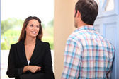 Door to door saleswoman — Stock Photo