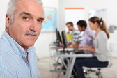 A teacher in his classroom — Stock Photo