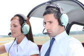 Man and woman in a light aircraft — Stock Photo