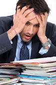 Stressed young businessman — Stockfoto