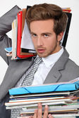 Man overwhelmed by files — Stock Photo