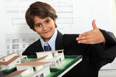 Boy dressed as a businessman in an architect's office — Photo