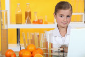 Girl analysing juice — Stock Photo