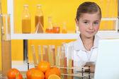 Girl analysing juice — Stock Photo