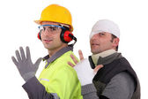A construction worker and his injured colleague. — Stock Photo