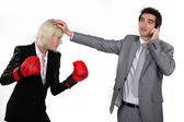 Businesswoman boxing a man on the phone — Stock Photo