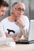 Elderly woman learning internet skills — Stock Photo