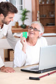 Mother and son talking about French health system — Stock Photo